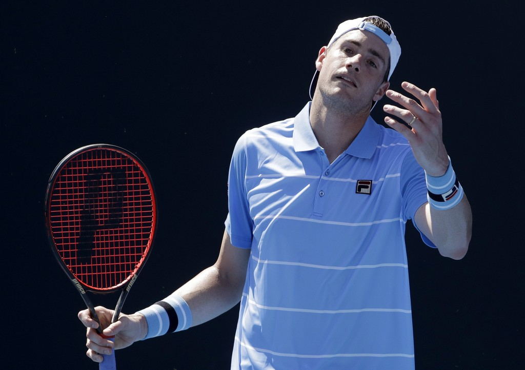 United States' John Isner reacts during his first round match against compatriot Reilly Opelka at the Australian Open tennis championships in Melbourn