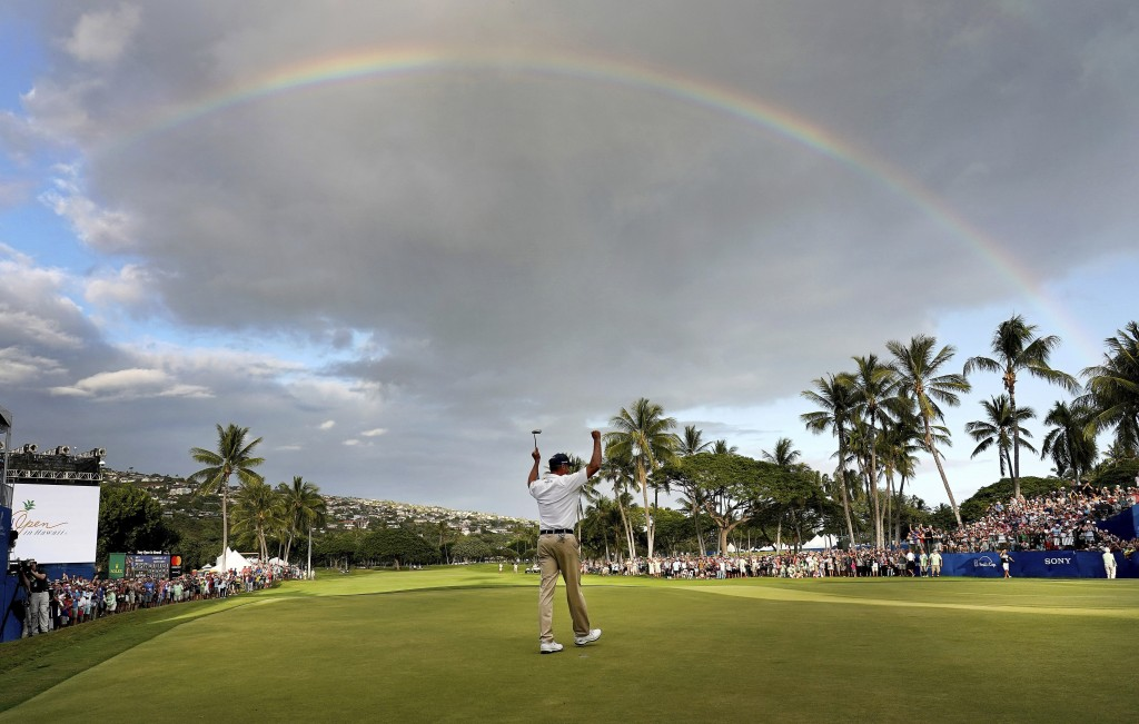 Matt Kuchar celebrates winning the Sony Open PGA Tour golf event, Sunday, Jan. 13, 2019, at Waialae Country Club in Honolulu. (AP Photo/Matt York)