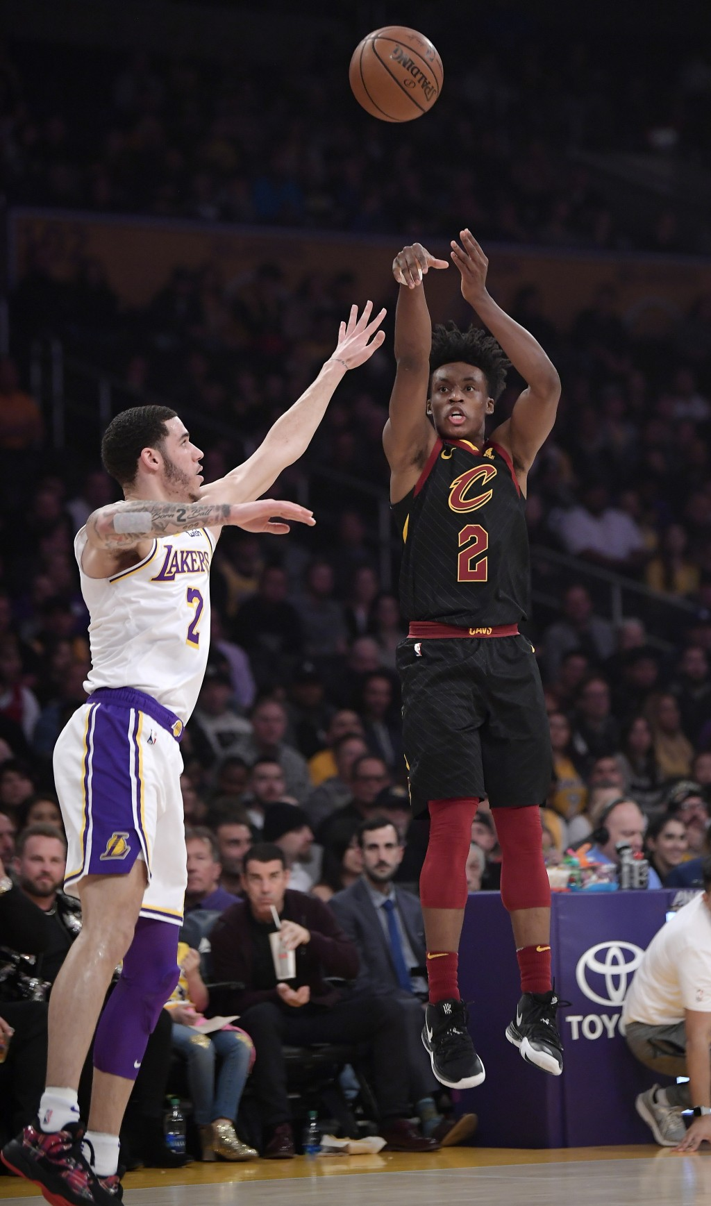 Cleveland Cavaliers guard Collin Sexton, right, shoots as Los Angeles Lakers guard Lonzo Ball defends during the first half of an NBA basketball game