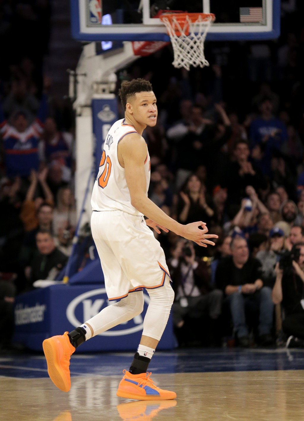 New York Knicks' Kevin Knox reacts after hitting a three-point basket during the second half of the NBA basketball game against the Philadelphia 76ers