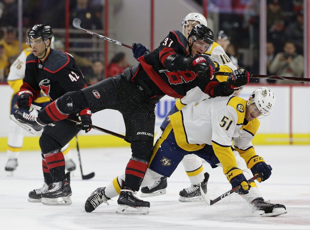 Carolina Hurricanes' Andrei Svechnikov (37), of Russia, collides with Nashville Predators' Austin Watson (51) during the second period of an NHL hocke...