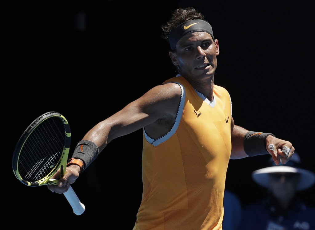 Spain's Rafael Nadal reacts after winning a point against Australia's James Duckworth during their first round match at the Australian Open tennis cha