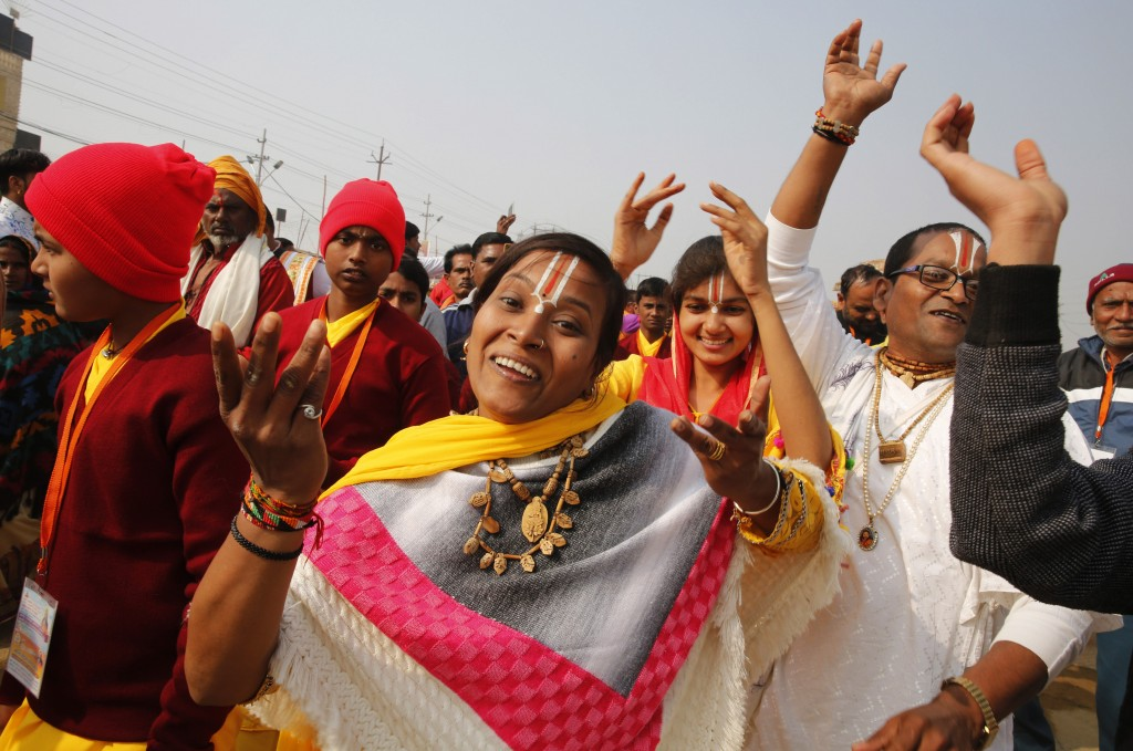 Hindu devotees march in a procession to participate in spiritual-cleansing baths in the Sangam, the confluence of the rivers Ganges, Yamuna, and the m