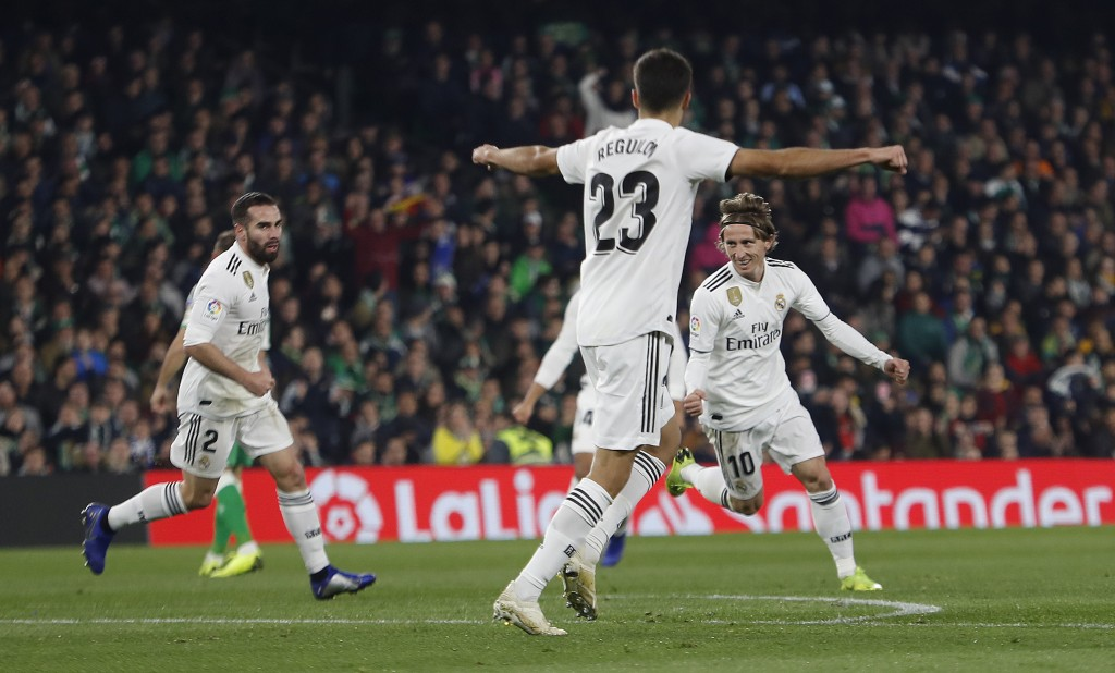 Real Madrid's Modric, right, celebrates after scoring against Betis during La Liga soccer match between Betis and Real Madrid at the Villamarin stadiu
