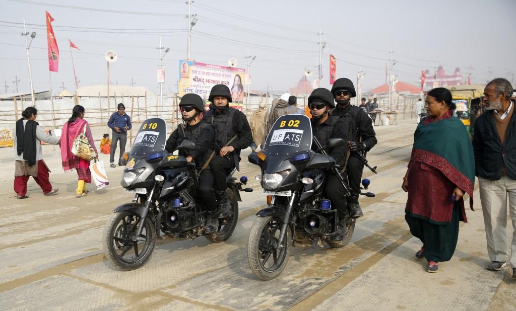 Uttar Pradesh police Anti-Terrorism Squad patrol on motorbikes at the spiritual-cleansing Kumbh Festival in Allahabad, India, Monday, Jan.14, 2019. In