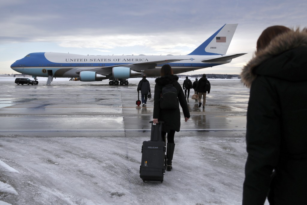 Members of the media walk across the tarmac to board Air Force One ahead of President Donald Trump's arrival at Andrews Air Force Base, Md., Monday Ja