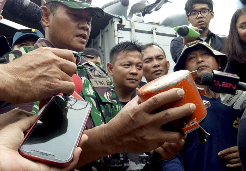 Indonesian Navy Commander Rear Admiral Yudo Margin shows the recovered cockpit voice recorder of Lion Air flight 610 that crashed into the sea in Octo