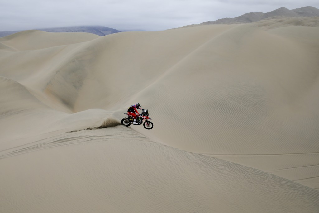 Ricky Brabec of United States rides his Honda motorbike during the stage six of the Dakar Rally between Arequipa and San Juan de Marcona, Peru, Sunday