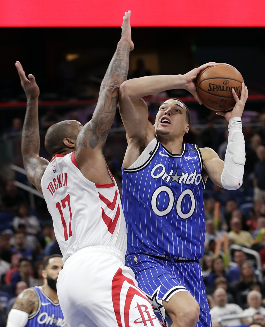 Orlando Magic's Aaron Gordon (00) shoots over Houston Rockets' P.J. Tucker, left, during the second half of an NBA basketball game, Sunday, Jan. 13, 2