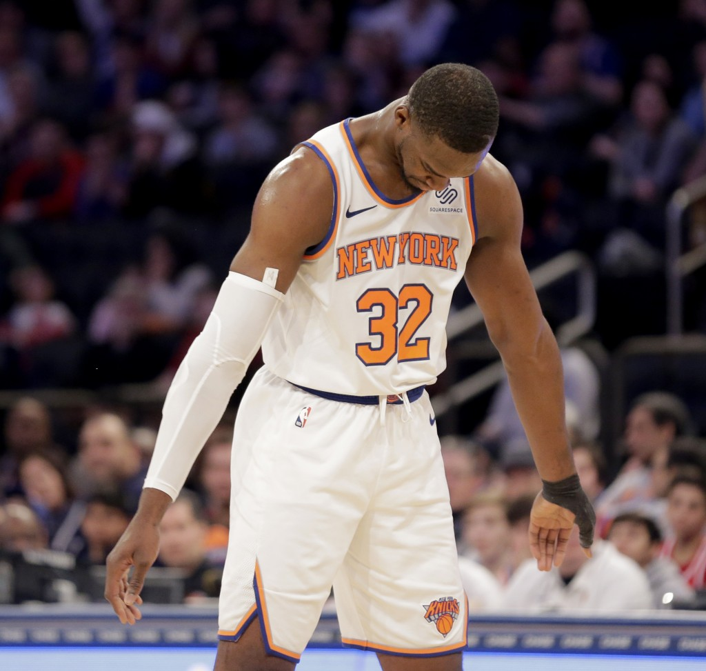 New York Knicks' Noah Vonleh reacts after being called for a foul during the first half of an NBA basketball game against the Philadelphia 76ers, Sund...