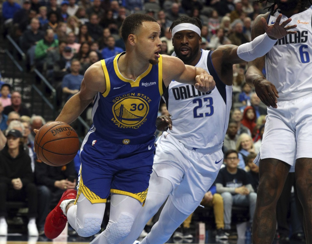 CORRECTS TO SUNDAY NOT WEDNESDAY - Golden State Warriors guard Stephen Curry (30) drives the ball past Dallas Mavericks guard Wesley Matthews (23) in
