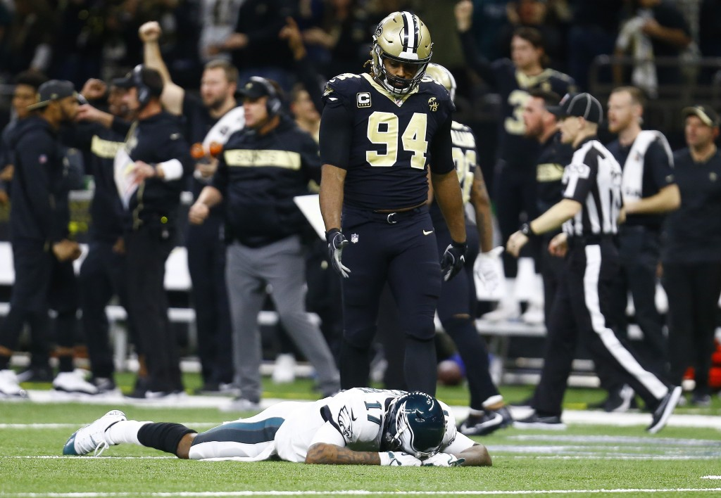 Philadelphia Eagles wide receiver Alshon Jeffery (17) lies on the turf in front of New Orleans Saints defensive end Cameron Jordan (94) after the Sain