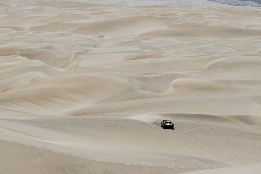 Driver Sebastien Loeb, of France, and co-driver Daniel Elena, of Monaco, race their Peugeot during the stage six of the Dakar Rally between Arequipa a