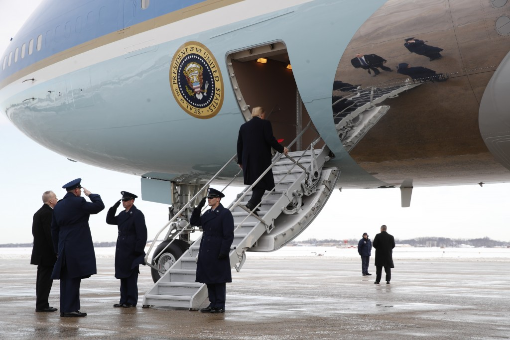 President Donald Trump boards Air Force One at Andrews Air Force Base, Md., Monday Jan. 14, 2019, en route to New Orleans. (AP Photo/Jacquelyn Martin)