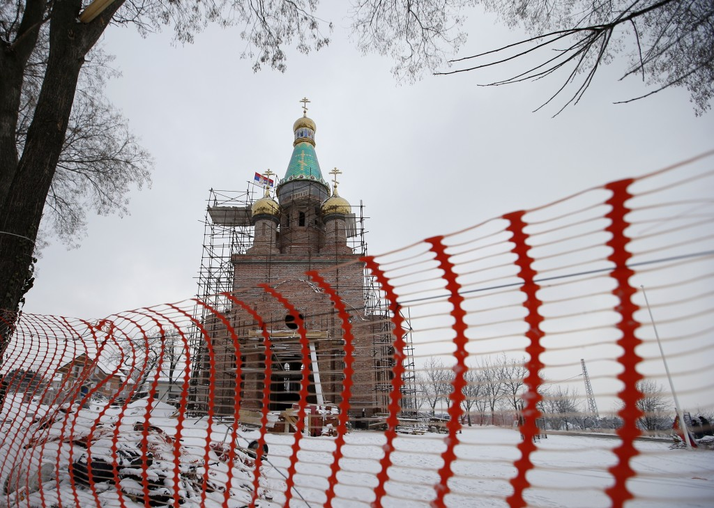 In this photo taken Friday, Jan. 11, 2019, a view of the new church under construction designed in the Russian style in the village Banstol in northwe