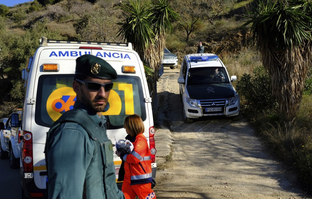 Emergency services look for a 2 year old boy who fell into a well, in a mountainous area near the town of Totalan in Malaga, Spain, Monday, Jan. 14, 2