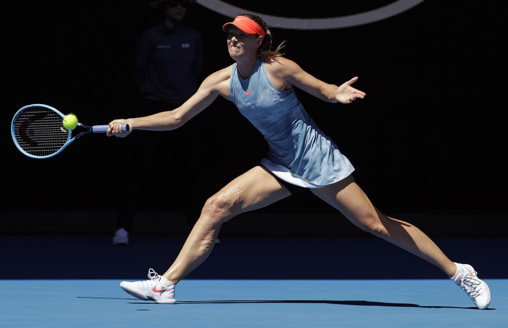 Russia's Maria Sharapova makes a forehand return to Britain's Harriet Dart during their first round match at the Australian Open tennis championships