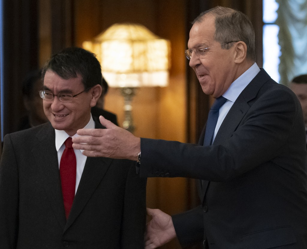 Russian Foreign Minister Sergey Lavrov, right, welcomes Japanese Foreign Minister Taro Kono for the talks in Moscow, Russia, Monday, Jan. 14, 2019. (A