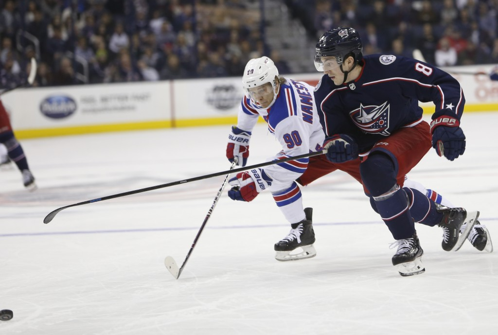 New York Rangers' Vladislav Namestnikov, left, of Russia, and Columbus Blue Jackets' Zach Werenski chase the puck during the first period of an NHL ho