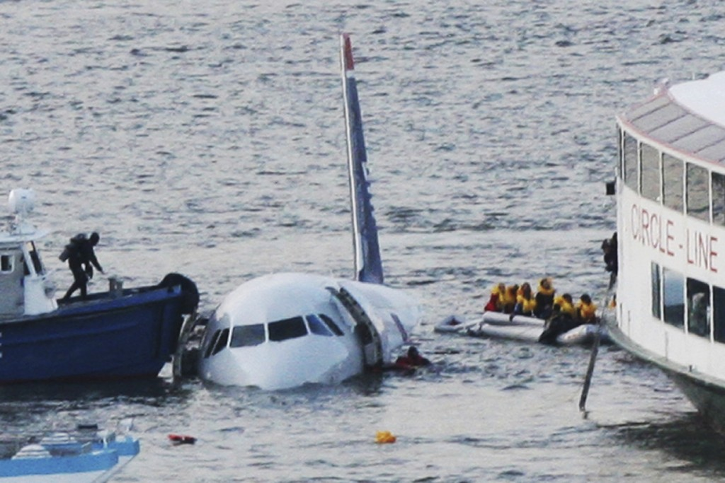 FILE - In this Jan. 15, 2009 file photo, a diver, left, aboard an NYPD vessel prepares to rescue passengers that escaped from the Airbus 320 US Airway...