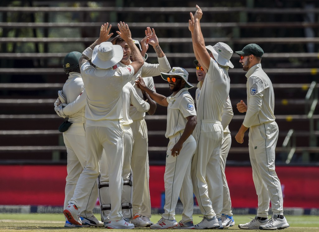 South Africa's bowler Duanne Olivier, center left facing, celebrates dismissing Pakistan's batsman Sarfraz Ahmed on day four of the third cricket test