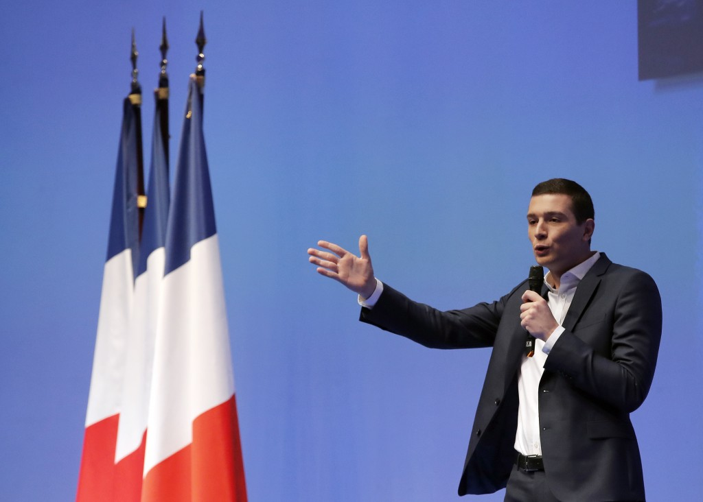 French far-right member Jordan Bardella delivers his speech during a campaign meeting in Paris, Sunday, Jan. 13, 2019. Marine Le Pen's French far righ