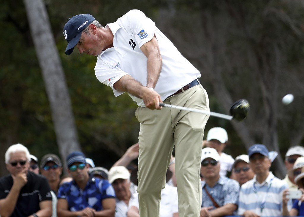 Matt Kuchar hits from the first tee during the final round of the Sony Open PGA Tour golf event, Sunday, Jan. 13, 2019, at Waialae Country Club in Hon