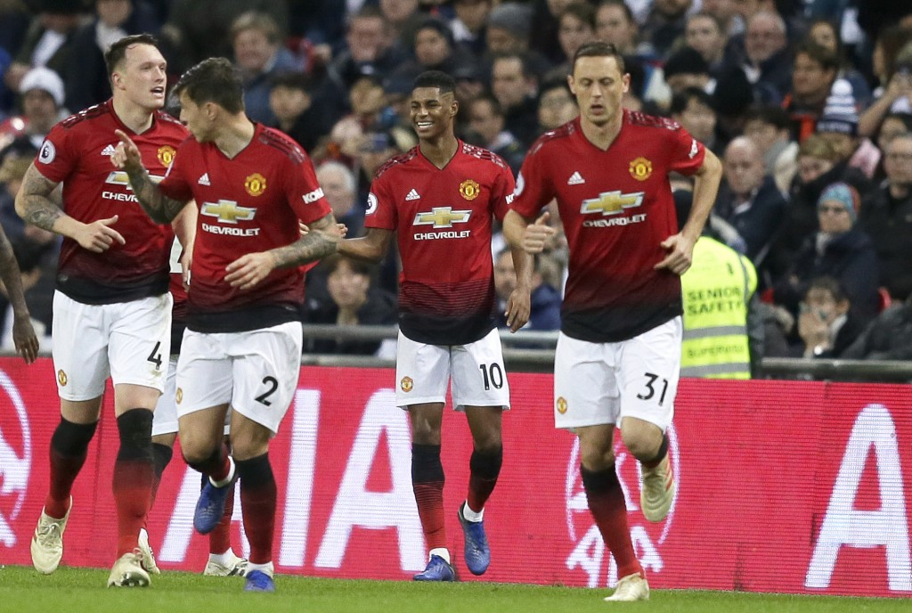 Manchester United's Marcus Rashford, 2nd right, celebrates after scoring the opening goal during the English Premier League soccer match between Totte