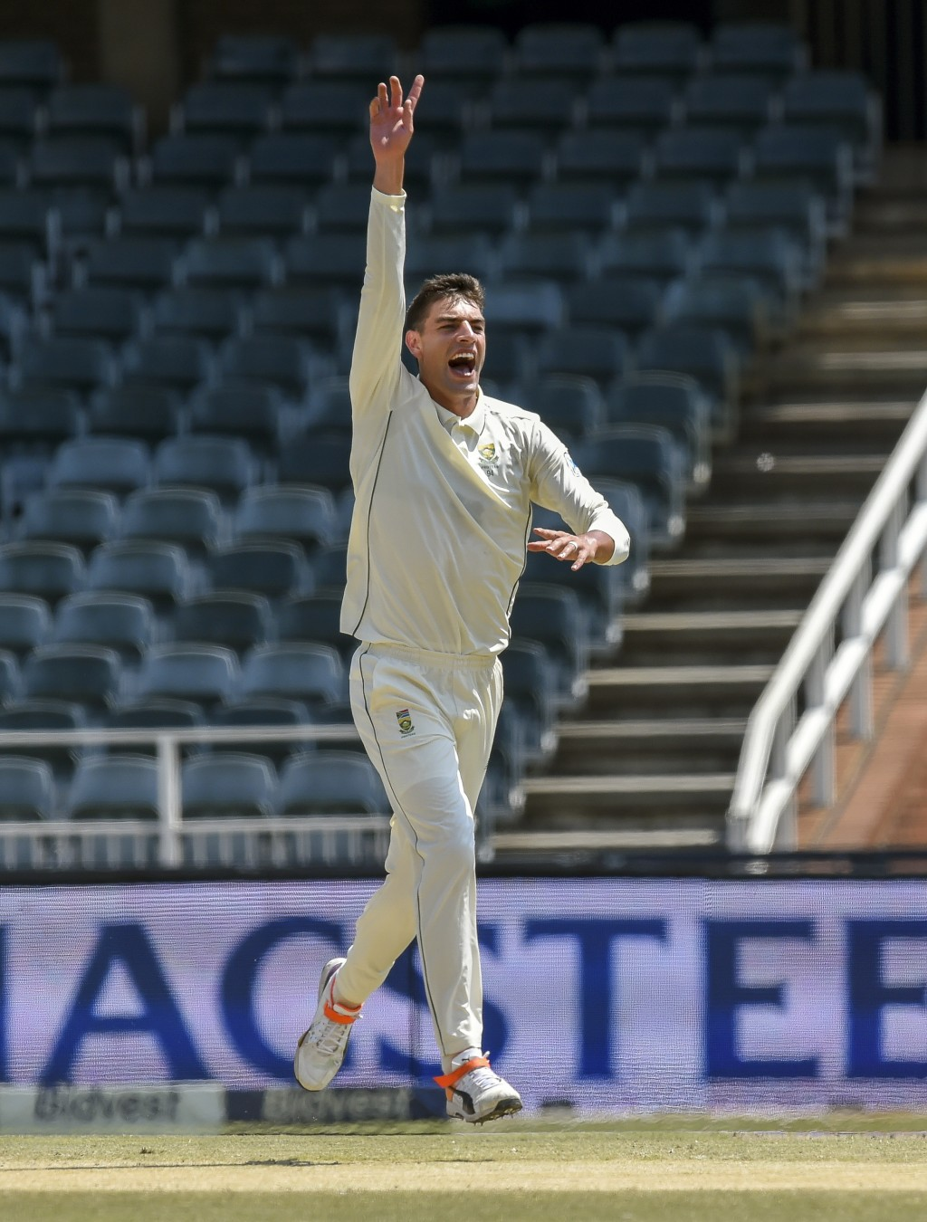 South Africa's bowler Duanne Olivier celebrates bowling Pakistan's batsman Asad Shafiq on day four of the third cricket test match between South Afric