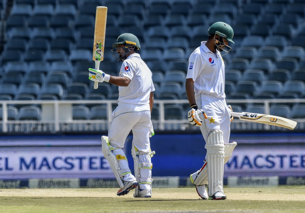 Pakistan's batsman Asad Shafiq, left, celebrates his fifty on day four of the third cricket test match between South Africa and Pakistan at Wanderers