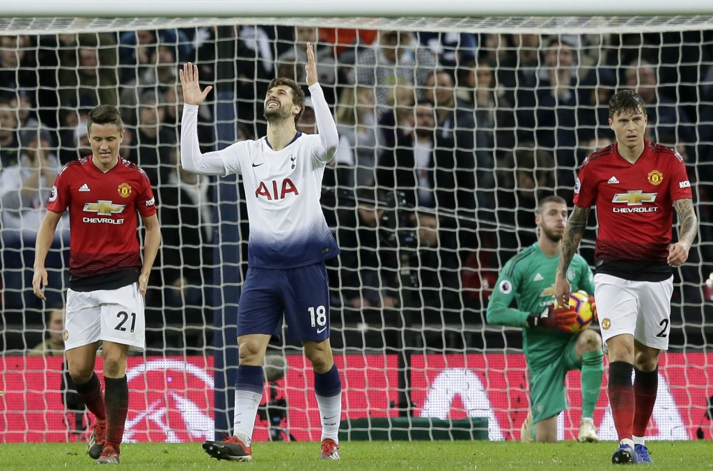 Tottenham's Fernando Llorente, center, reacts after a missed chance to score during the English Premier League soccer match between Tottenham Hotspur