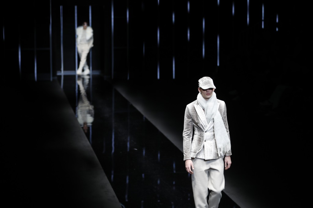 A model wears a creation as part of the Emporio Armani men's Fall-Winter 2019-20 collection, that was presented in Milan, Italy, Monday, Jan.14, 2019.