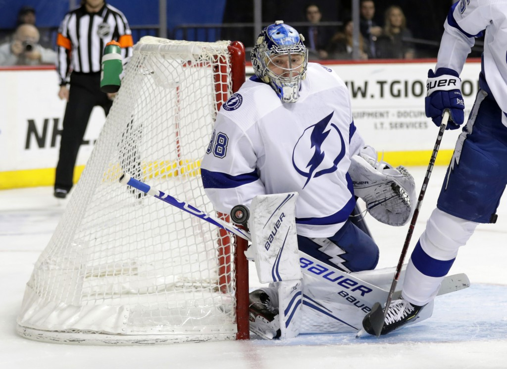 Tampa Bay Lightning goaltender Andrei Vasilevskiy (88) stops a shot on the goal during the second period of an NHL hockey game against the New York Is
