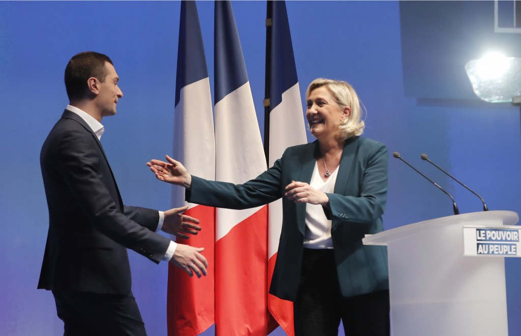French far-right leader Marine le Pen greets Jordan Bardella during a campaign meeting in Paris, Sunday, Jan. 13, 2019. Le Pen's French far right part