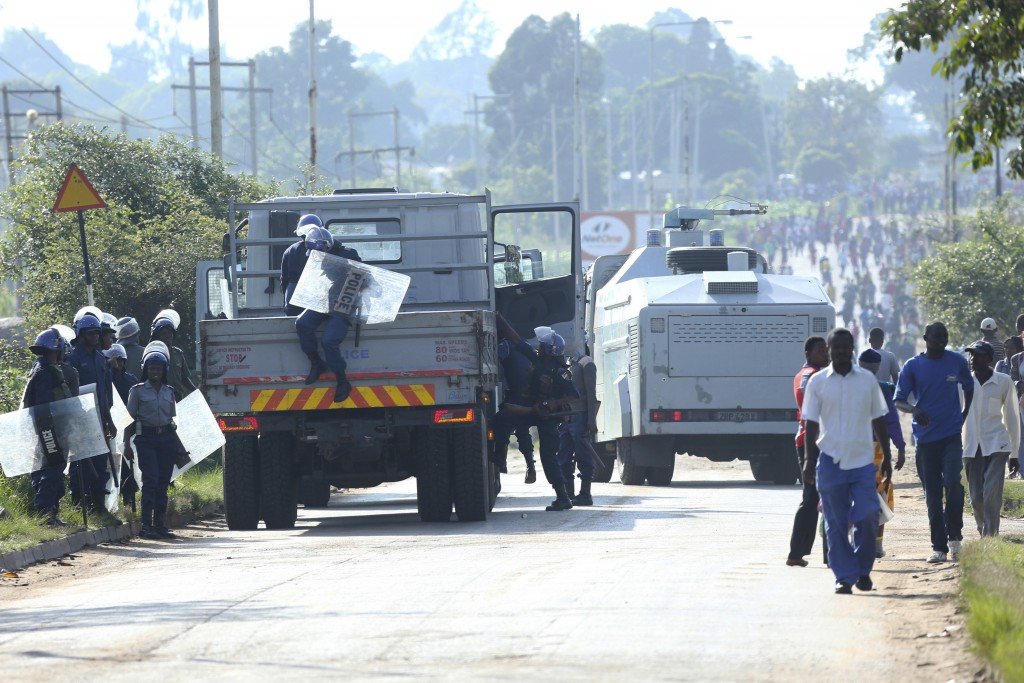 Riot police are seen on a street during a demonstration over the hike in fuel prices in Harare, Zimbabwe, Monday, an. 14, 2019. Zimbabwean President E