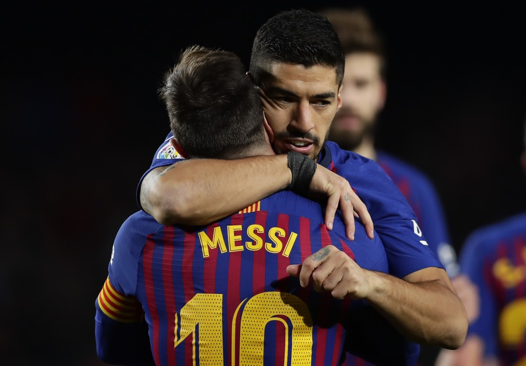 FC Barcelona's Lionel Messi celebrates after scoring his side's second goal with his teammate Luis Suarez during the Spanish La Liga soccer match betw