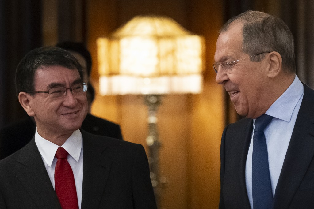 Russian Foreign Minister Sergey Lavrov, right, and Japanese Foreign Minister Taro Kono enter a hall for their talks in Moscow, Russia, Monday, Jan. 14
