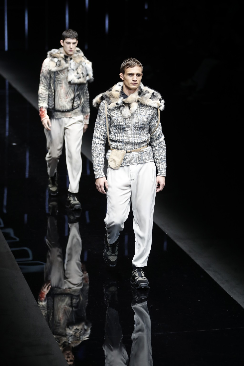 Models wear creations as part of the Emporio Armani men's Fall-Winter 2019-20 collection, that was presented in Milan, Italy, Monday, Jan.14, 2019. (A