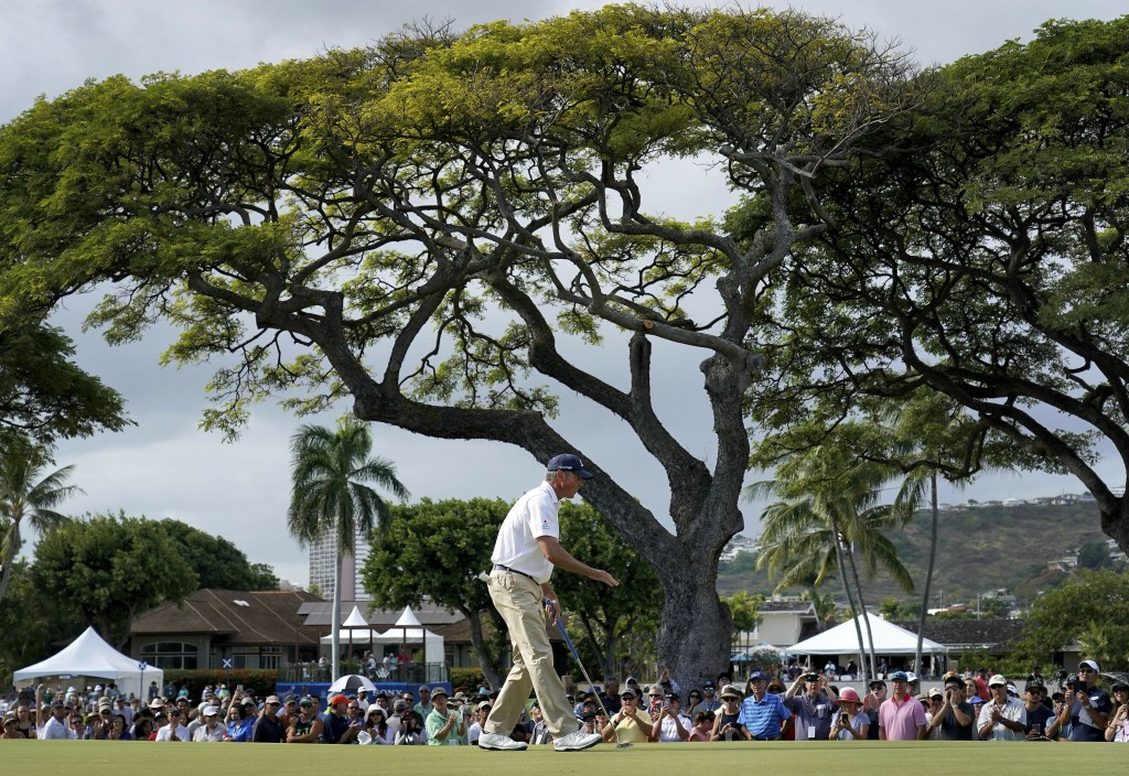 Matt Kuchar makes birdie on the 10th green during the final round of the Sony Open PGA Tour golf event, Sunday, Jan. 13, 2019, at Waialae Country Club