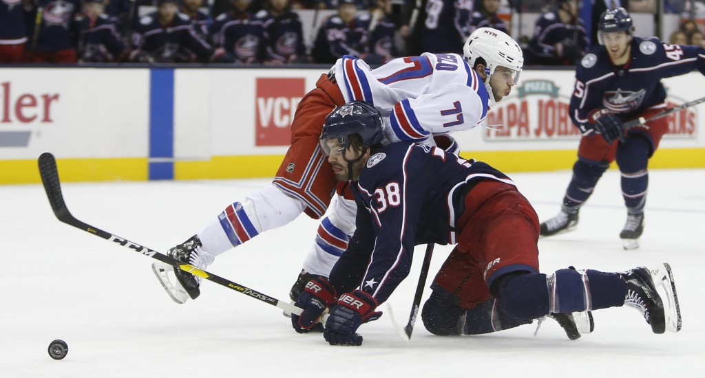 New York Rangers' Tony DeAngelo, top, collides with Columbus Blue Jackets' Boone Jenner during the second period of an NHL hockey game Sunday, Jan. 13