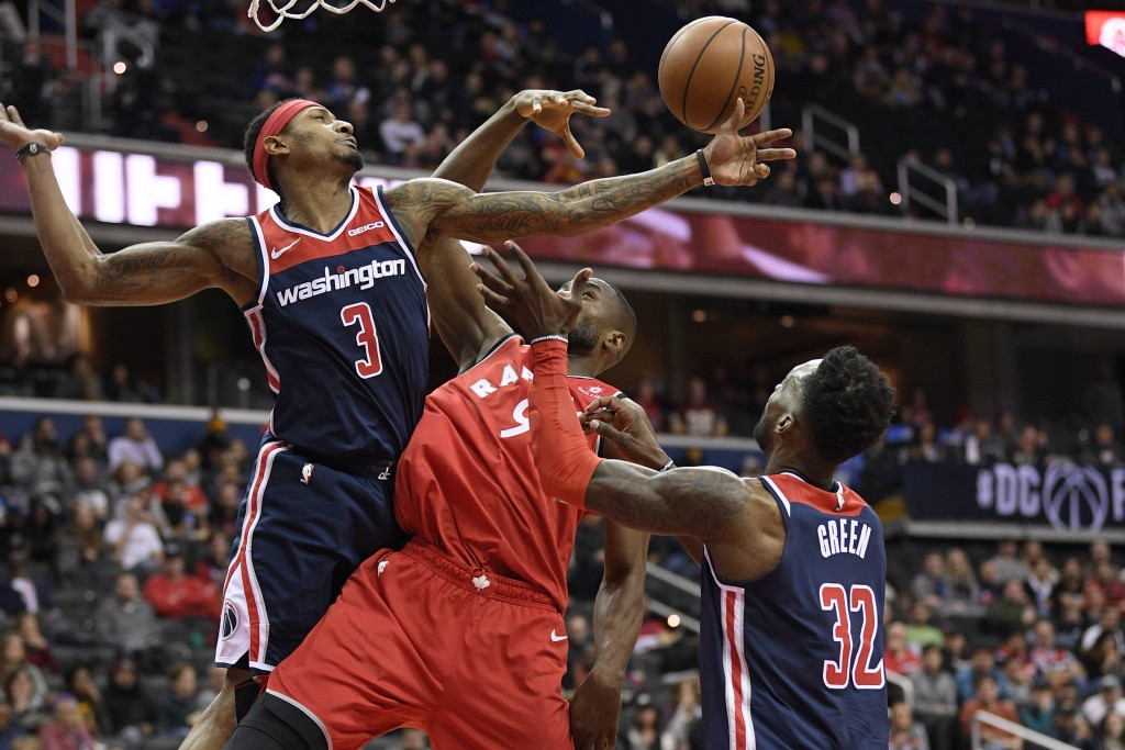 Washington Wizards guard Bradley Beal (3) and forward Jeff Green (32) battle for the rebound against Toronto Raptors forward Serge Ibaka (9) during th