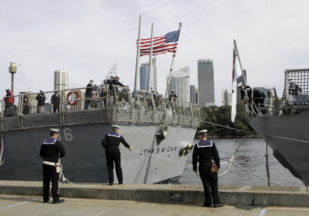 FILE - In this Aug. 20, 2008, file photo, Australian sailors tie up the USS John S McCain (DDG-56) as she arrives in Sydney, Australia for the 100th A