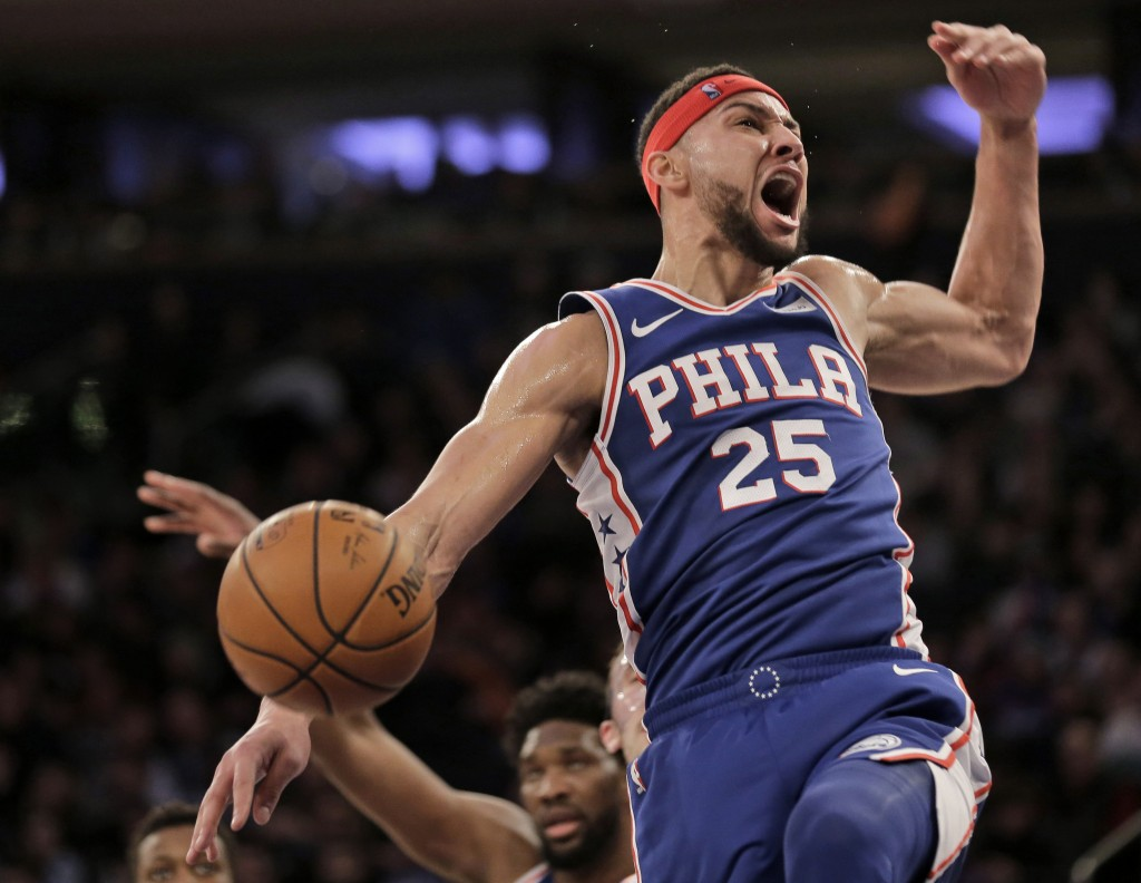 Philadelphia 76ers' Ben Simmons reacts after dunking during the first half of an NBA basketball game against the New York Knicks, Sunday, Jan. 13, 201