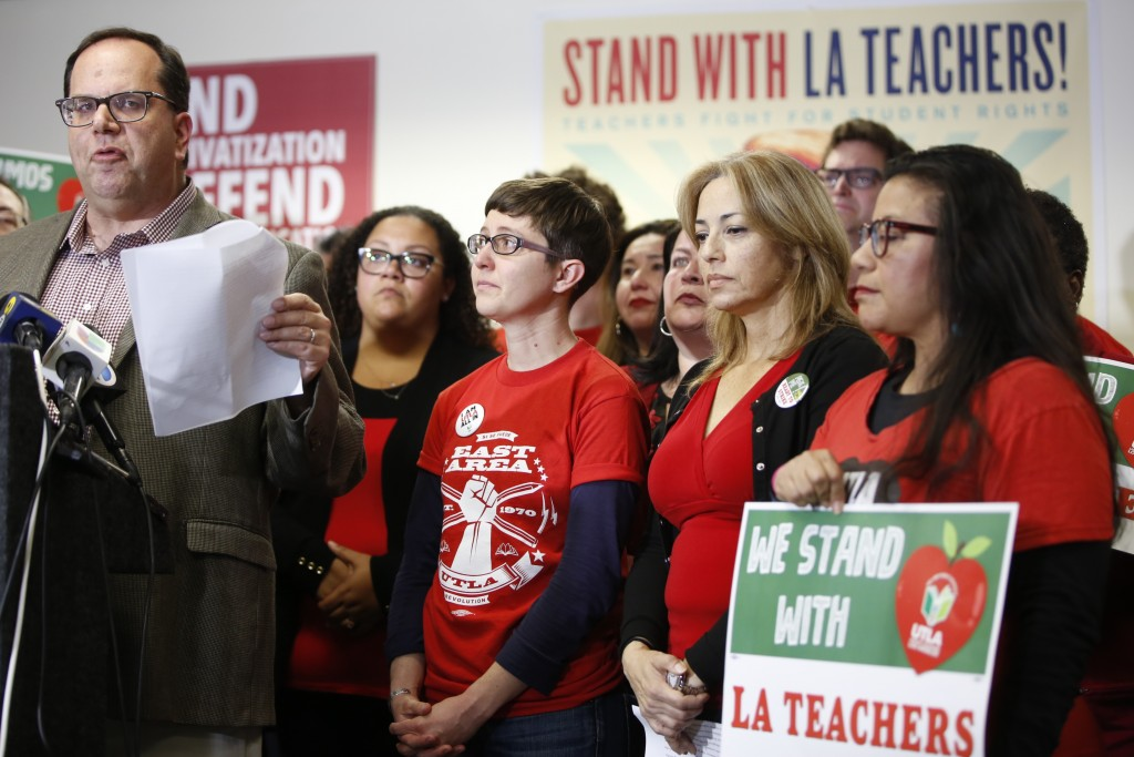 United Teachers Los Angeles president and teacher, Alex Caputo-Pearl, far left, at podium, announces the nation's second-largest school district will