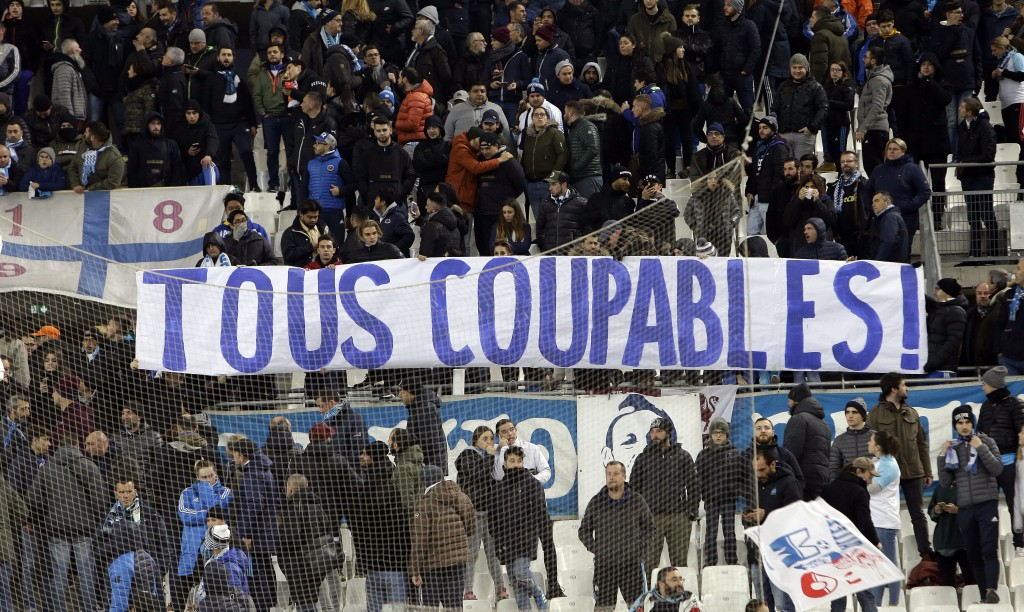 """Marseille supporters display a banner reading """"All guilty"""" after the bad results of their team during the League One soccer match against Monaco at th"""