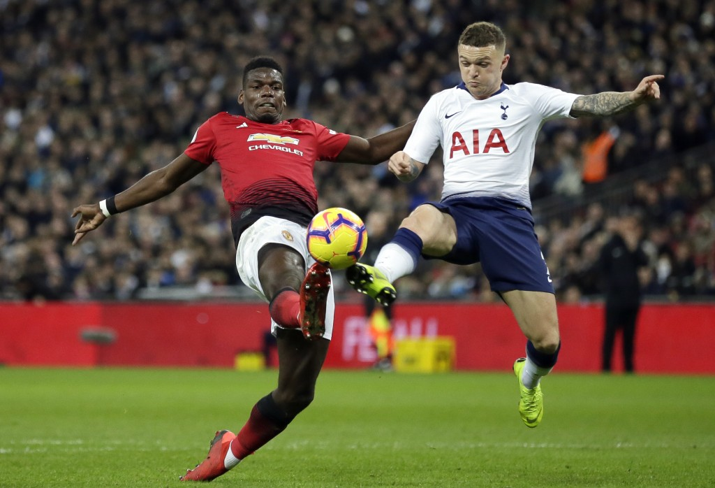 Manchester United's Paul Pogba vies for the ball with Tottenham's Kieran Trippier, right, during the English Premier League soccer match between Totte