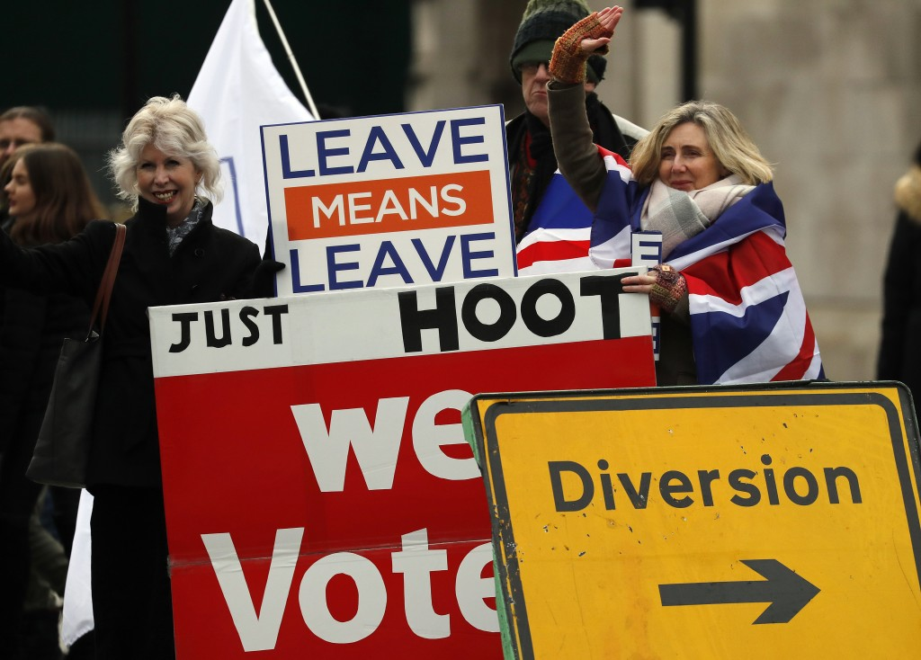 Leavers display banners opposite the Houses of Parliament to protest against the Brexit-Deal in London, Monday, Jan. 14, 2019. Britain's Prime Ministe