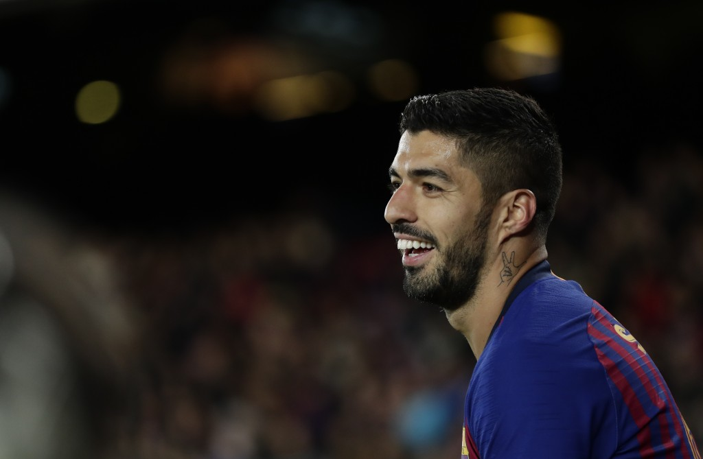 FC Barcelona's Luis Suarez smiles during the Spanish La Liga soccer match between FC Barcelona and Eibar at the Camp Nou stadium in Barcelona, Spain,
