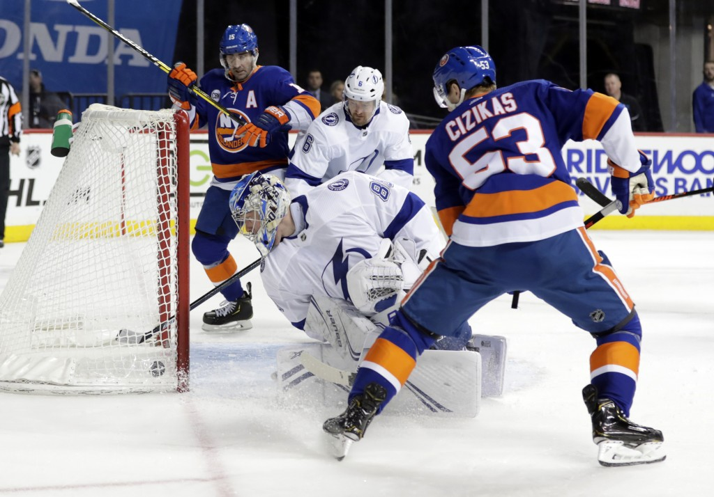 Tampa Bay Lightning goaltender Andrei Vasilevskiy (88) watches the puck shot by New York Islanders' Casey Cizikas (53) get past him for a goal during