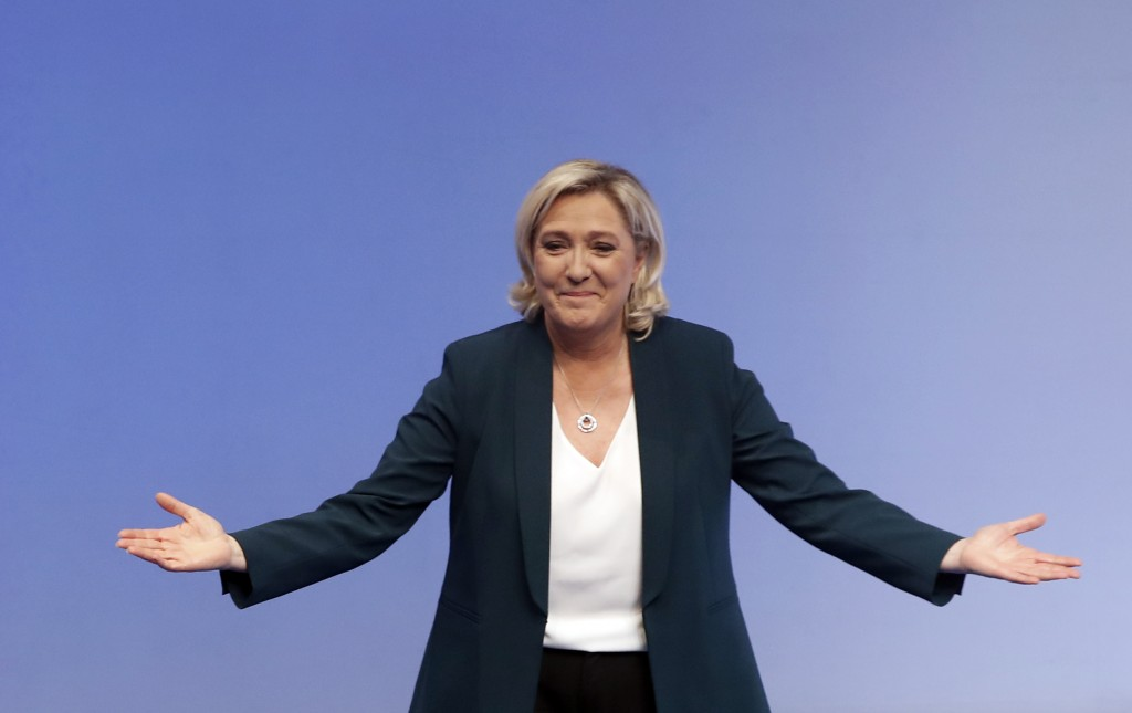 French far-right leader Marine le Pen arrives for a campaign meeting in Paris, Sunday, Jan. 13, 2019. Le Pen's French far right party National Rally h
